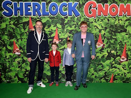 Elton John dresses up with David Furnish and sons for Halloween rendition of 'Crocodile Rock'