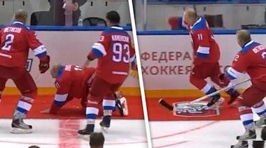 Vladimir Putin Eats It on Ice