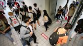 As the Coronavirus Comes to School, a Tough Choice: When to Close