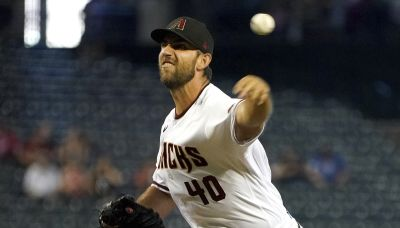 Kelly, lowly D-Backs rally past NL East-leading Braves 6-4