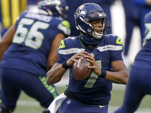 Seahawks re-sign QB Geno Smith to back up Russell Wilson for another year