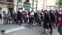 Catalonia Police Sprayed With Paint During Barcelona Demonstration