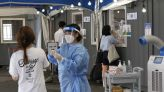 The Latest: South Korea hits pandemic high for daily cases