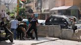 Lebanon pauses amid tense calm after deadly gun battles