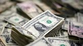 CANADA FX DEBT-Canadian dollar slips as trade balance swings to surprise deficit By Reuters