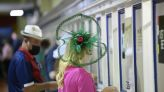 The Latest: Preakness day record $112.5M wagered on races