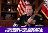 Arnold Schwarzenegger uses a sword to describe the strength of democracy