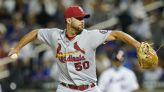 Cardinals soar into playoff position behind ageless arms