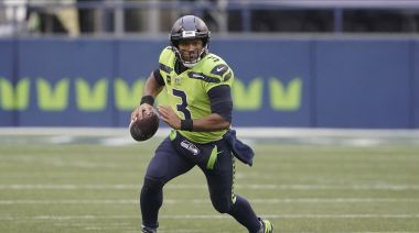 Russell Wilson stays busy on and off the NFL field