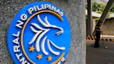 UPDATE 2-Philippine c.bank surprises with 5th rate cut this year as economy struggles