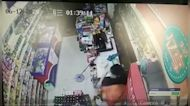 Shop assistant in China smashes six beer bottles on knife-wielding robber's head to subdue him