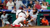 Harper's throw to plate saves Phillies' 4-3 win over O's