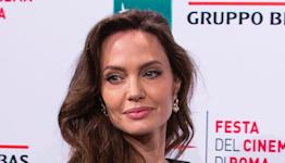 Angelina Jolie Embodies Classic Elegance in a One-Shoulder Dress & Platforms for 'Eternals' Rome Premiere