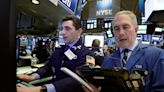 Dow books record high even as Powell warns on inflation