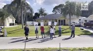 Protesters outside home of Brian Laundrie's parents hold up signs and chant 'Justice for Gabby'