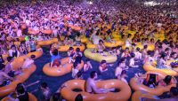 Thousands cram into huge Wuhan pool party at coronavirus 'ground zero'