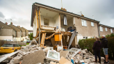 Shocking pictures show house lying in ruins after three people survive huge gas explosion