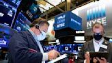 Stocks close mixed as regulators seek pause in J&J vaccine
