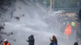 Health pass protest continues at Italian port despite police water cannon, tear gas