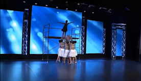 Girl teeters from high platform - then 'angel' dancers come to her rescue with majestic performance