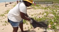 Residents organize an effort to clean one of Nigeria's longest beaches