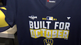 'We are getting to be connoisseurs of postseason material'; Brewers fans add to their collection of playoff gear