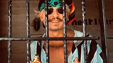 Johnny Depp poses with Polish film festival award in bizarre photo behind bars
