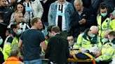 U.K. soccer players stop match after spotting collapsed fan in stands, help get him medical aid