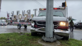 Ambulance towing giant 'Trump Unity' sign crashes into telephone pole in Michigan