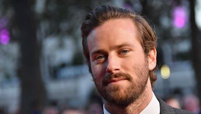 Armie Hammer's role in Death on the Nile 'not currently' being reshot despite rape allegation