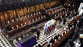 Queen Elizabeth II sits alone at Prince Philip's funeral; family says farewell at St. George's Chapel