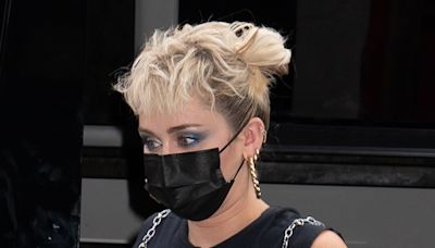Miley Cyrus Is Edgier Than Ever in a Punk Plaid Skirt, Fishnet Tights & Bow-Tied Platforms