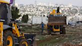 Israel announces new settlements, risking Biden's anger
