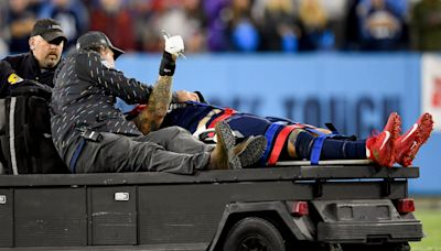 Tennessee Titans OT Taylor Lewan carted off during Buffalo Bills game, being evaluated for concussion