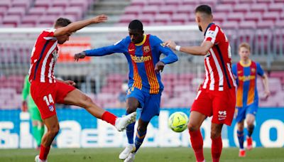 Title rivals Barcelona and Atletico Madrid share spoils in Nou Camp stalemate