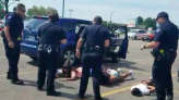Video shows Black children handcuffed face down on the pavement