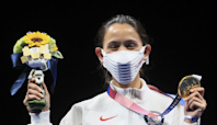 Mystery Solved: What's with the U.S.'s big podium masks?