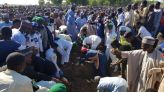 Nigeria buries 43 farmers killed by militants, dozens missing