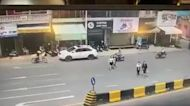 Moment woman suffers double motorcycle snatch theft in Cambodia