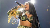 Megan Thee Stallion Dances In A Sparkling Orange Bikini & Ignores Haters After Grammys