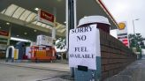 Gas stations run dry in Britain as trucker shortage sparks hoarding