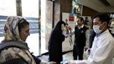 Coronavirus has hit Iran's 'resistance economy' set up to combat US sanctions – and ordinary Iranians are worried