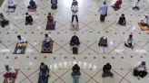 Asia Today: Indonesians return to mosques, at a distance
