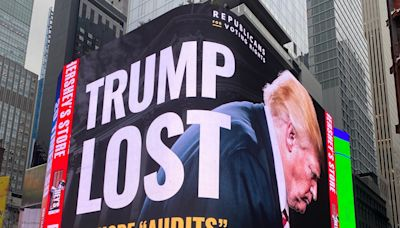 A Republican group is putting up gigantic billboards to remind Trump that he lost