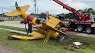 Small plane crashes into highway