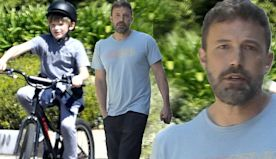 Ben Affleck greets his bicycle-riding son Samuel outside his house