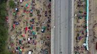 Drone video shows migrants under Texas bridge