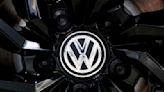 Tesla-chaser Volkswagen lifts margin outlook again after record profit