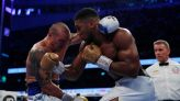 Boxing-Usyk outclasses Joshua to claim world heavyweight titles
