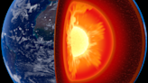Earth's lopsided core? Strangeness in our planet's interior